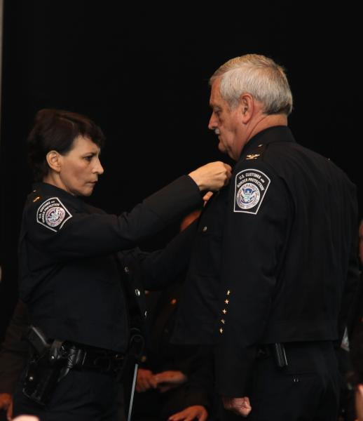 Brandt received his Port Director's badge, pinned on by his wife, Carmen Brandt, who serves as a Supervisory CBP Officer.