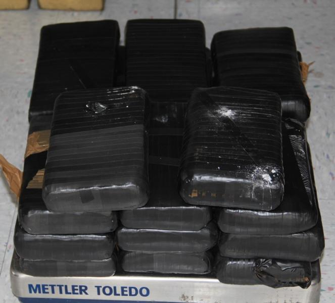 CBP officers retrieved 20 packages of cocaine from underneath the center console area of the vehicle.