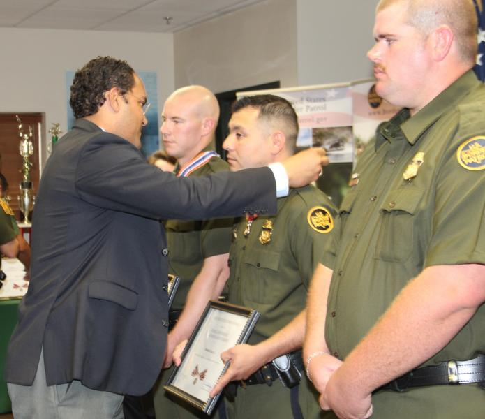 From left: U.S. Rep. Will Hurd (Texas - Dist. 23) presents the Congressional Badge of Bravery to Border Patrol Agents Christopher J. Smilo, Rolando Cantu and James Barfield.