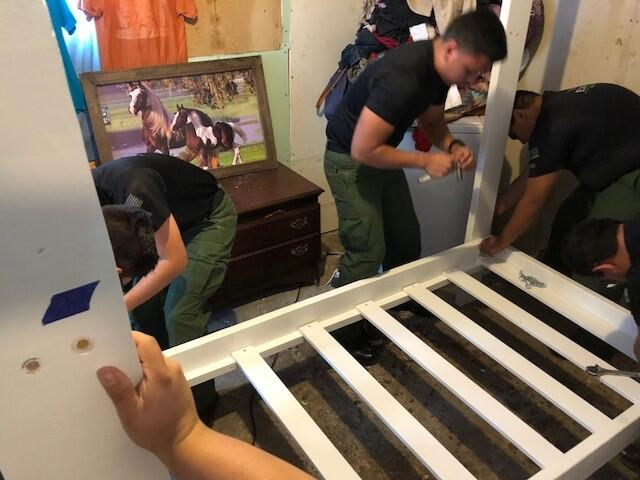 Explorers built beds from scratch, painted them, and delivered them to families.