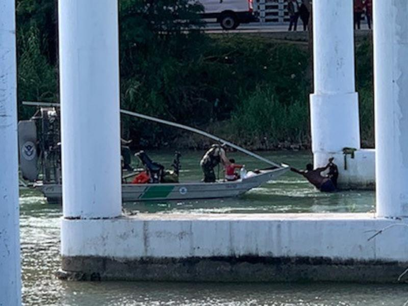 Agents noticed several individuals in the Rio Grande River, clinging to the stone pillars of the International Bridge.