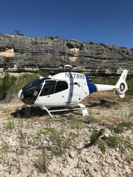 An air crew member aboard this CBP Air and Marine helicopter disembarked to check on a group of people spotted in a remote location.  He learned that one person was in medical distress. The air crew transported her to a local hospital.