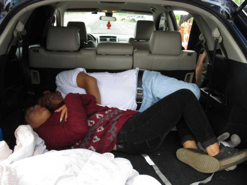 Agents discovered two undocumented Mexican nationals hidden in the rear cargo area.
