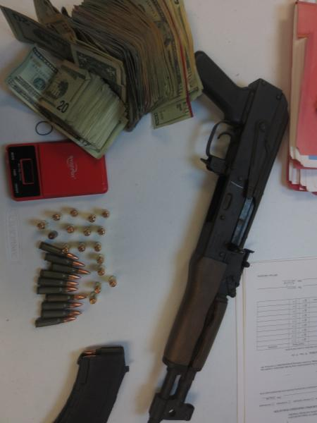 . Inspection of the vehicle resulted in discovery of an AK-47 pistol underneath the driver's seat.