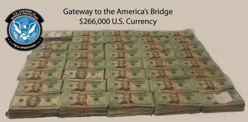 Stacks of bills totalling $266,000 in unreported currency seized by CBP officers and agents at Laredo Port of Entry