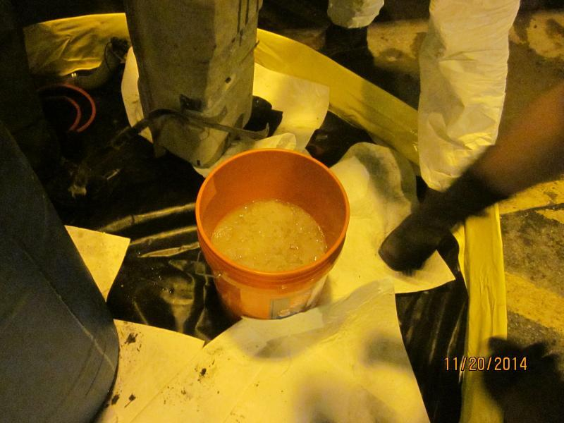 Bucket containing liquid methamphetamine, part of an 112-pounds meth load valued at $3.5 million seized by Border Patrol agents at Falfurrias checkpoint
