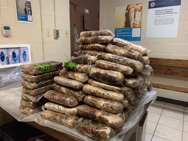 Packages containing 131 pounds of methamphetamine and 18 pounds of heroin seized by CBP officers at Progreso International Bridge