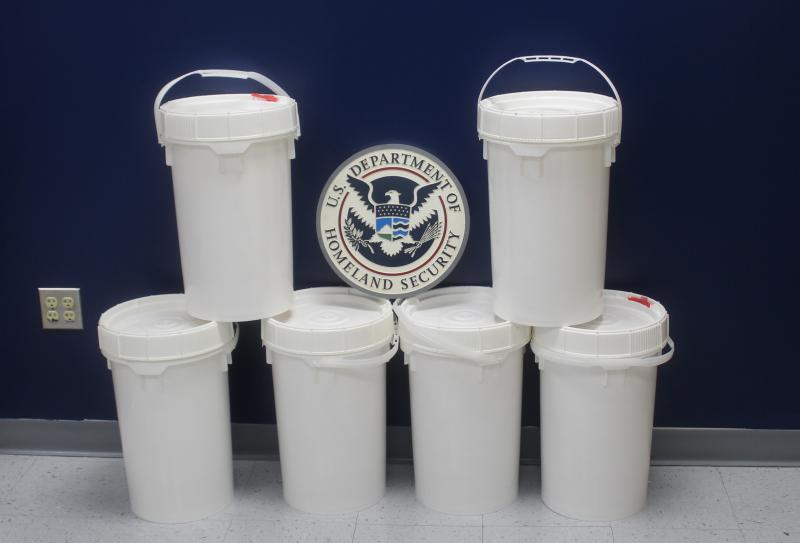 Buckets containing 149 pounds of methamphetamine seized by CBP officers at Colombia-Solidarity Bridge.