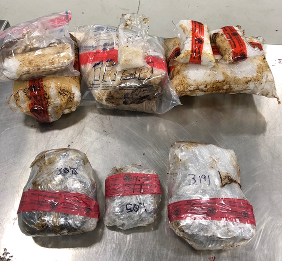 Packages containing 16 pounds of heroin and 26.74 pounds of methamphetamine seized by CBP officers at JUarez-Lincoln Bridge in Laredo, Texas.