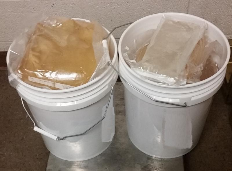 Buckets containing packages totaling 64.82 pounds of methamphetamine seized by CBP officers at Brownsville Port of Entry