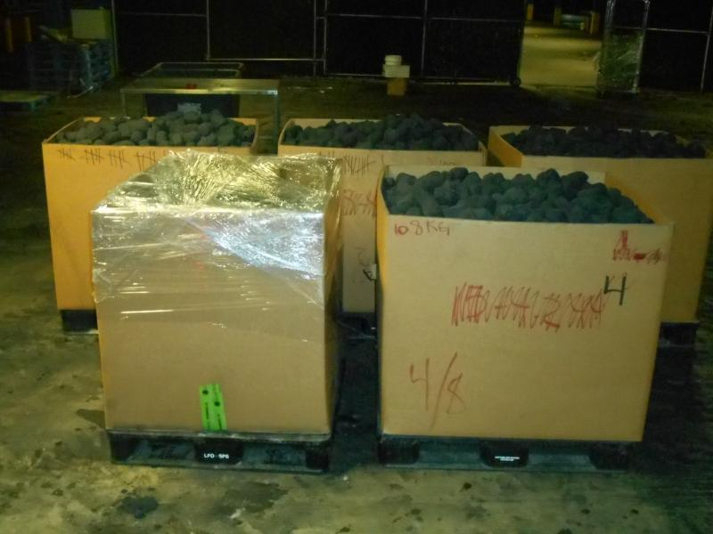Boxes containing charcoal bricks from which CBP officers seized 2,804 pounds of marijuana at Laredo Port of Entry