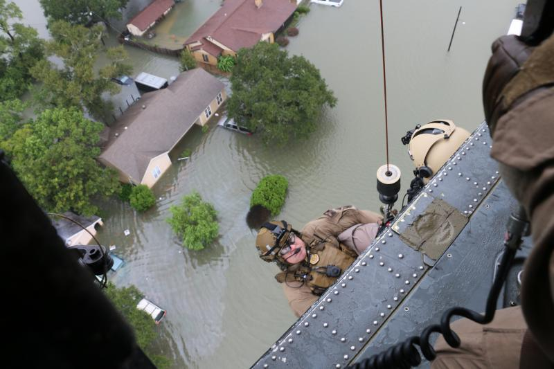 CBP Air and Marine agents prepared to descend to rescue disaster survivors during search and rescue missions in support of Hurricane Harvey response.