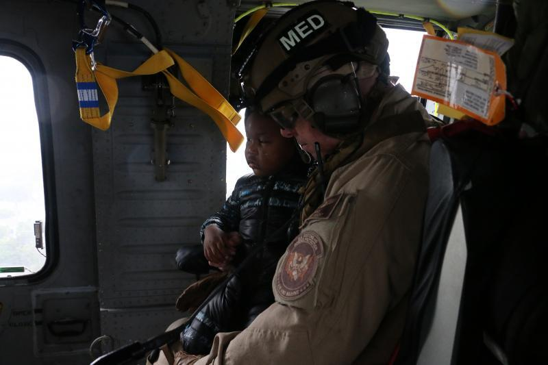 AMO Air and Marine Emergency Medical Services crew members transport a four-year-old male criticla care patient from a flood-impacted Beaumont hospital to another medical facility