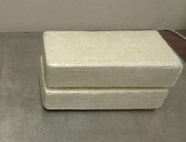 Packages containing 4.54 pounds of cocaine hidden within a cake seized by CBP officers at Hidalgo International Bridge