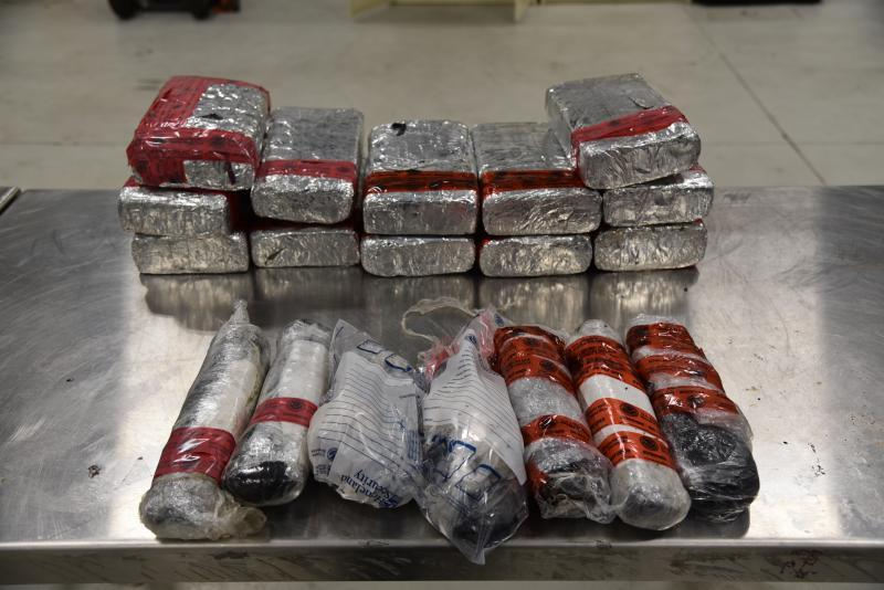 Packages containing 56 pounds of methamphetamine and 16 pounds of heroin seized by CBP officers at Juarez-Lincoln Bridge in Laredo, Texas.