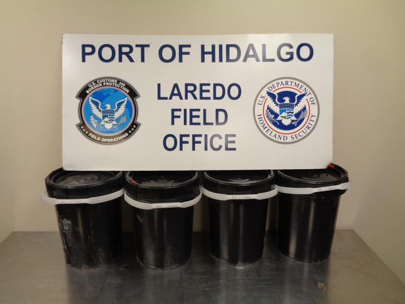 Plastic containers filled with 163 pounds in liquid methamphetamine seized by CBP officers at Hidalgo Port of Entry