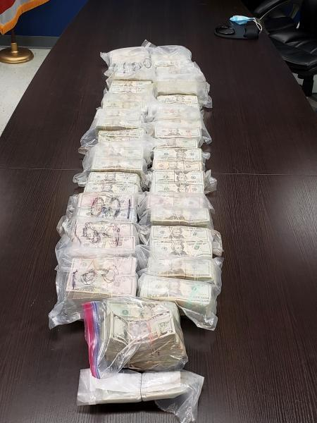 Stacks containing $838,481 in unreported currency seized by CBP officers at Roma Port of Entry