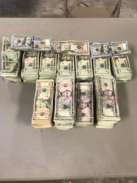 Packages containing $90,367 in unreported currency seized by CBP officers at Laredo Port of Entry