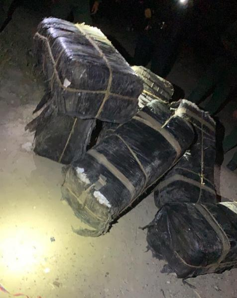 Bundles containing 745 pounds of marijuana seized by Border Patrol agents near the Rio Grande near Laredo, Texas