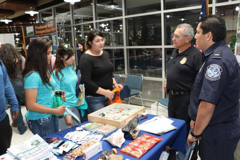 A CBP agriculture specialist and a CBP agriculture technician provide information regarding CBP's agriculture mission at expo held at TExas State Technical College in Harlingen, Texas