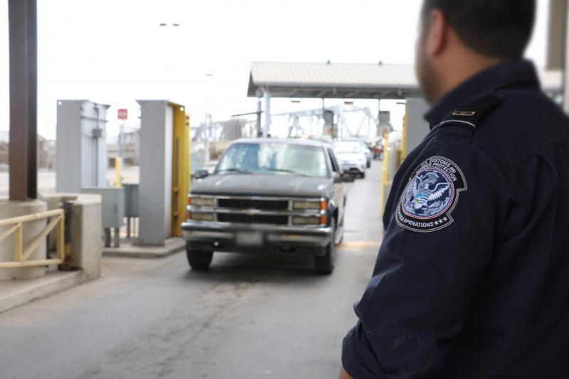 A CBP officer conducts a primary inspection at Brownsville Port of Entry