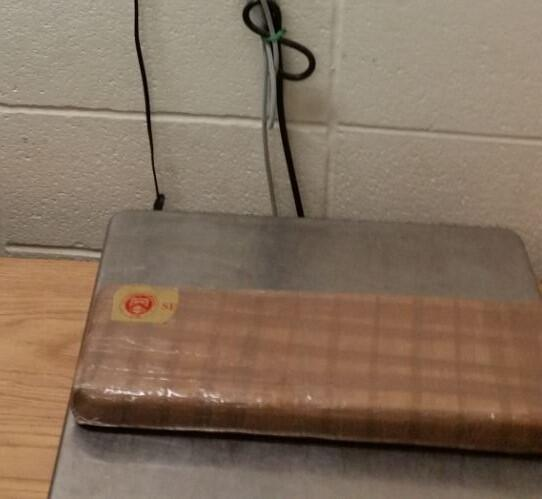 A package containing four pounds of cocaine seized by CBP officers at Roma Port of Entry