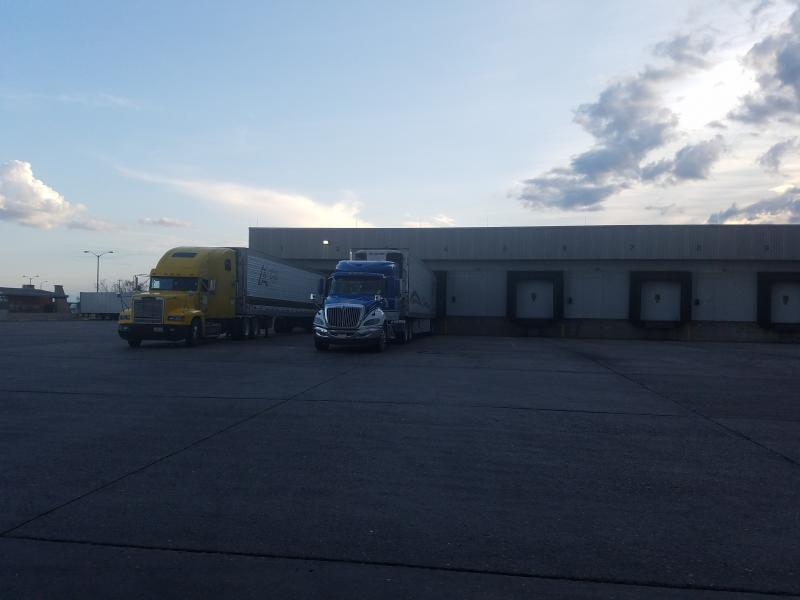 Commercial trucks undergo CBP agriculture specialist examination in the cold storage inspection facility at World Trade Bridge that recently came back online during business resumption efforts