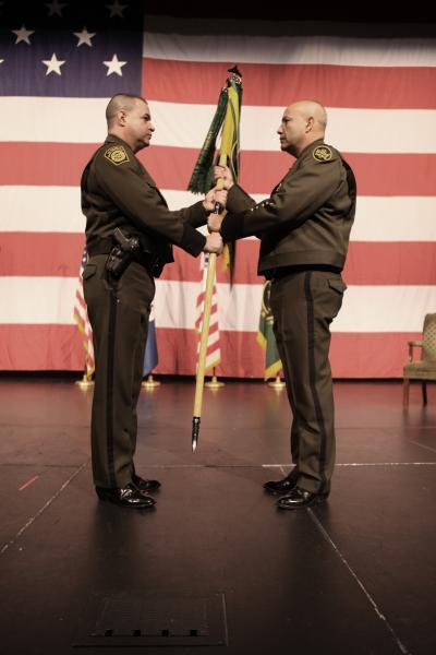 Chief of the U.S. Border Patrol Michael Fisher presents guidon to Laredo Sector Chief Patrol Agent Mario Martinez in Change of Command ceremony