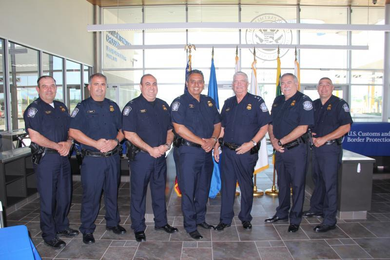 Assistant Port Director Gil Aldaz, fourth from left, celebrates his retirement from U.S> Customs and Border Protection after more than 32 years of federal service