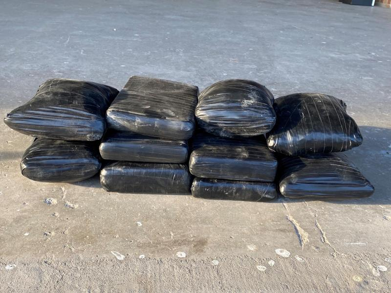 Packages containing 23 pounds of heroin and three pounds of cocaine seized by CBP officers at Hidalgo International Bridge