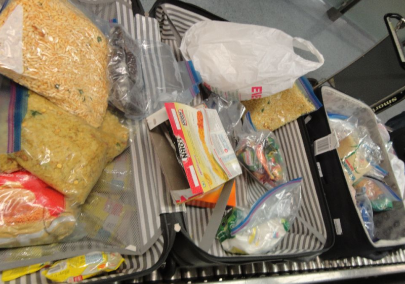 CBP agriculture specialists discovered more than five pounds of prohibited agricultural products in the Global Entry member's luggage.