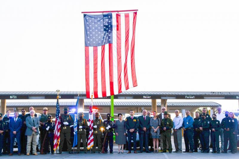 CBP officers, together with other federal, state and local law enforcement partners and stakeholders stand in formation during the 9/11 20th memorial ceremony held at Del Rio Port of Entry