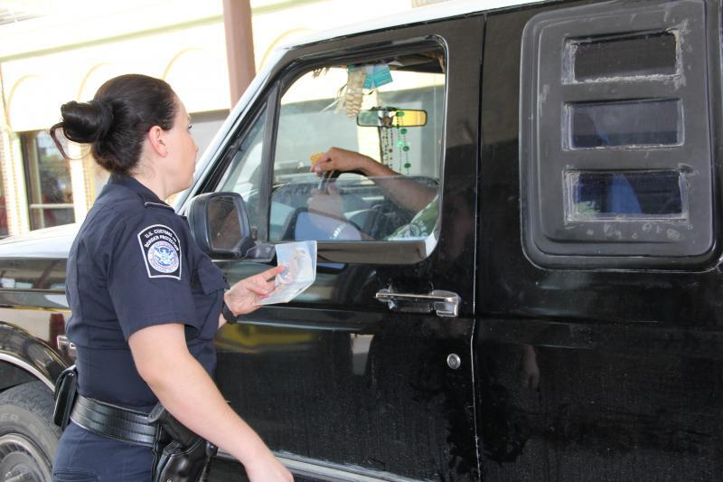 A CBP officer conducts a primary inspection at Donna International Bridge