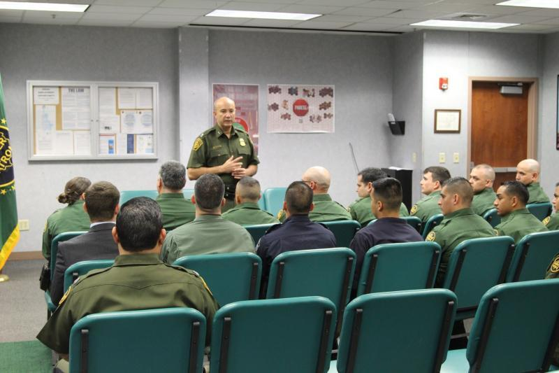 Laredo Sector Chief Patrol Agent Mario Martinez addresses 17 officers and agents from multiple federal agencies that recently graduated from a 10-week Emergency Medical Technician (EMT) course provided by U.S. Border Patrol, Laredo Sector.