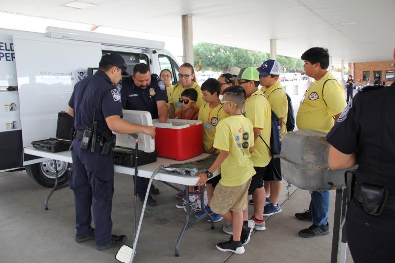 Children of CBP employees observe different items used to conceal narcotics during Eagle Pass Port of Entry's annual Bring Your Child to Work Day