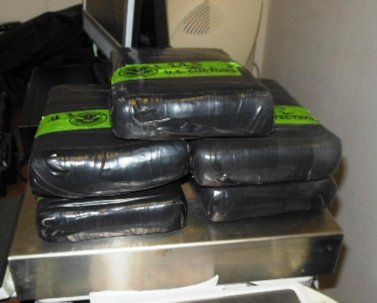 Bundles containing 13.43 pounds of cocaine seized by CBP officers at Brownsville Port of Entry
