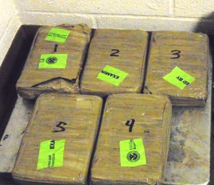 Bundles containing 12.39 pounds of cocaine seized by CBP officers at Gateway Bridge, one of two significant hard narcotics interceptions occurring at Brownsville Port of Entry this week