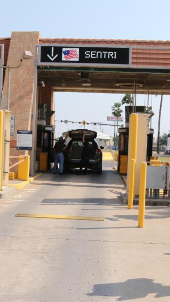 A CBP officer conducts a primary inspection in the SENTRI lane at Hidalgo International Bridge