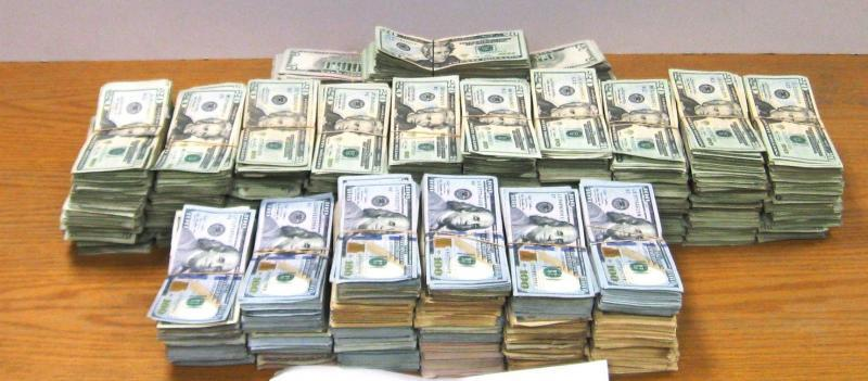 Stacks of bills containing $269,525 in unreported currency seized by CBP officers during an outbound examination at Hidalgo International Bridge