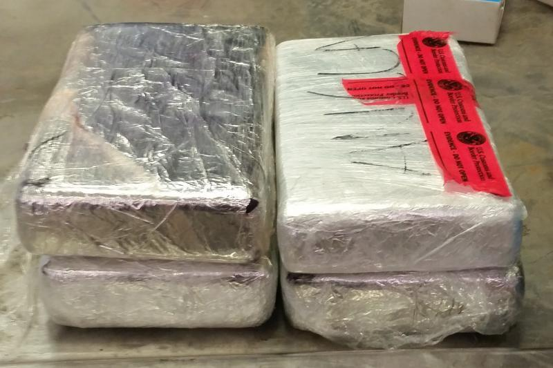 Packages containing 11 pounds of cocaine seized by CBP officers at Laredo Port of Entry from a SENTRI lane participant