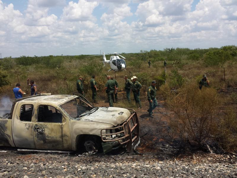 U.S. Border Patrol agents, Laredo Air Branc air assets converge on an abandoned vehicle loaded with 2,102 pounds of marijuana that had caught on fire near Bruni, Texas