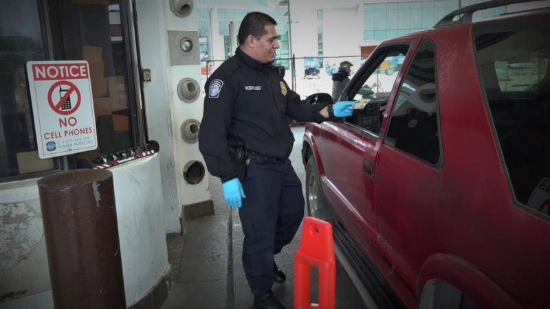 A CBP officer conducts a primary inspection at Laredo Port of Entry