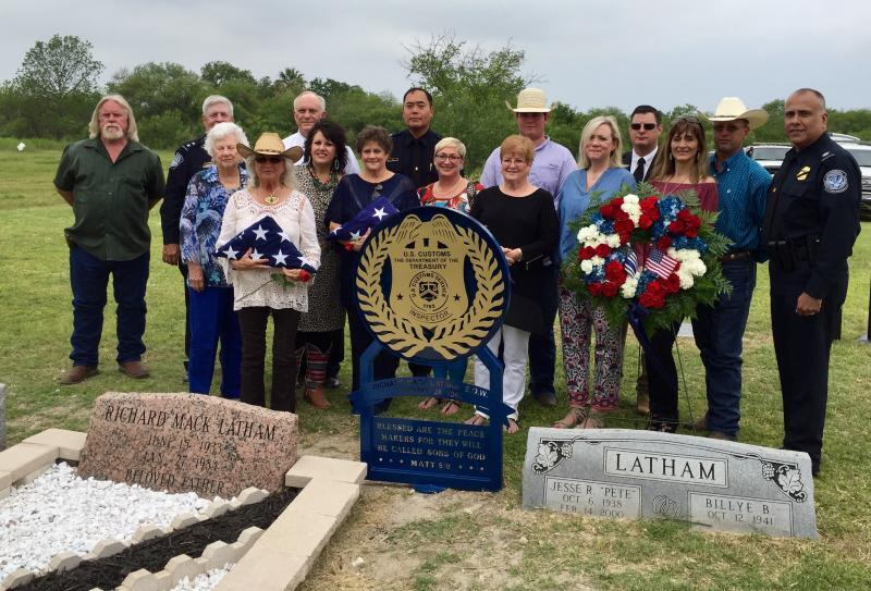 Members of the Wallen-Latham family and CBP management pose for a group photo at the refurbished gravesite and memorial marker for U.S. Customs Inspector Richard Mark Latham, killed in the line of duty on Jan. 27, 1984