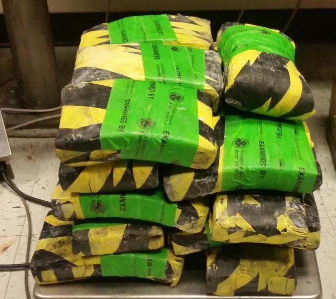 Packages containing 63 pounds of cocaine seized by CBP officers at Lareod Port of Entry
