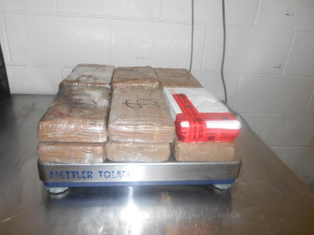Packages containing a total of nearly 28 pounds of cocaine seized by CBP officers at World Trade Bridge