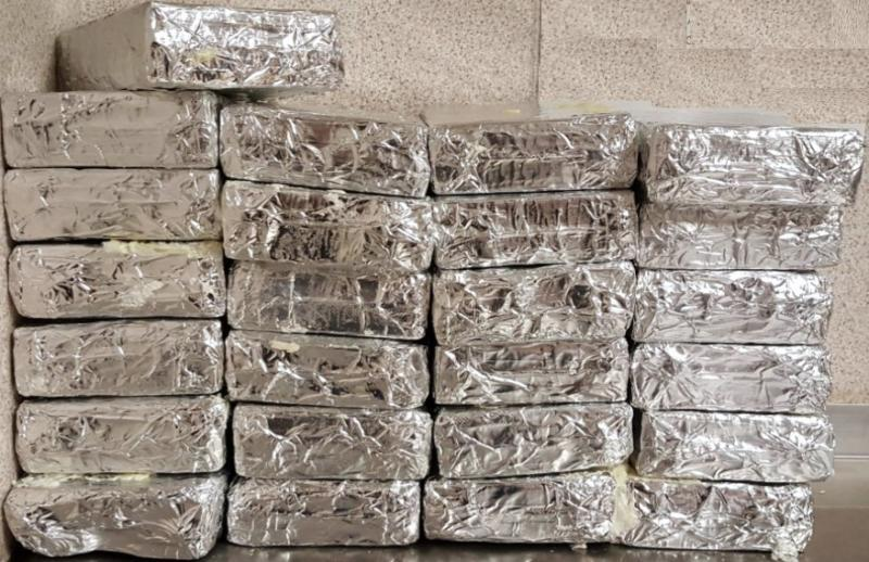 Packages containing 26.6 pounds of cocaine seized by CBP officers at Brownsville Port of Entry