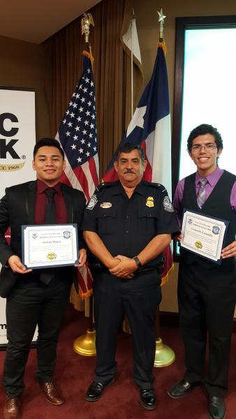 High school students Joshua Duque, left and Leonardo Escamilla, from United South and Cigarroa High Schools, respectively pose with Assistant Port Director Frank Garcia during the Port Director for Day event hosted at Laredo Port of Entry