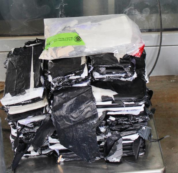 Packages containing 54 pounds of heroin seized by CBP officers at Pharr International Bridge.