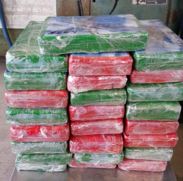 Packages containing 59.44 pounds cocaine seized by CBP officers at Hidalgo POE
