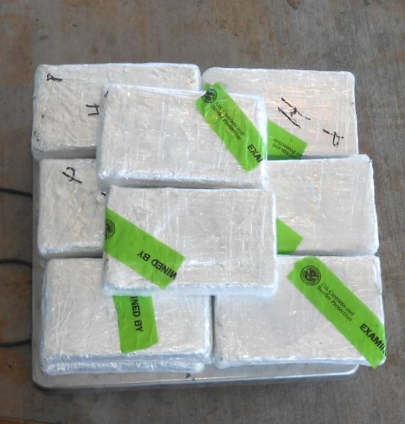 Bundles containing 33 pounds of cocaine seized by CBP officers at Pharr International Bridge